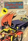 Picture of Detective Comics #233, featuring Batwoman on the cover riding a motorcycle, outrunning Batman and Robin